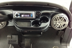Golf cart with head unit and speakers installed