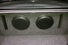 2012 Ford Mustang - 2 10'' JL Audio W3 subwoofers installed in a custom ported enclosure with a panel to make the enclosure look like it is part of the trunk.