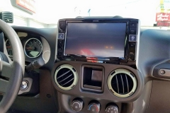 "2015 Custom Jeep Wrangler with Alpine 9"" navigation radio installed"
