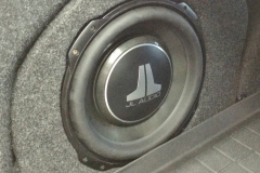 2014 VW Passat - custom fiberglass enclosure molded behind wheel well for JL Audio 12TW3 subwoofer