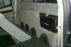 Toyota Tacoma - amp & subs installed behind the rear seat